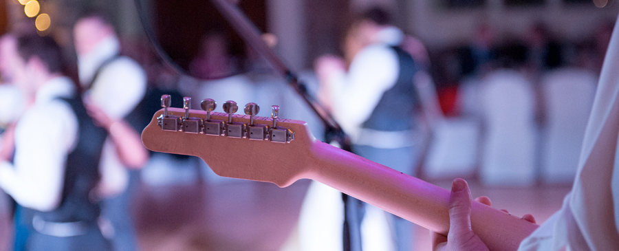 Juice Wedding Band Nothern Ireland | pic of a bride and groom from behind Rod