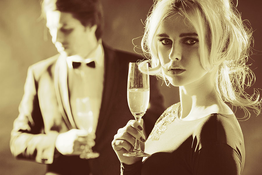 Photo of a woman drinking champagne at a formal