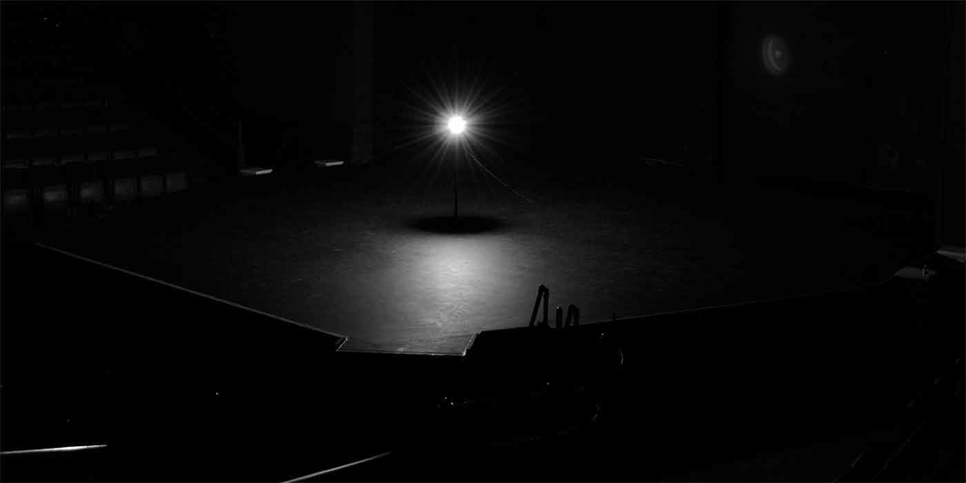 Photo of a single light shining on a stage
