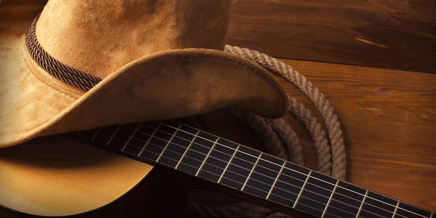 Photo of a cowboy hat and guitar