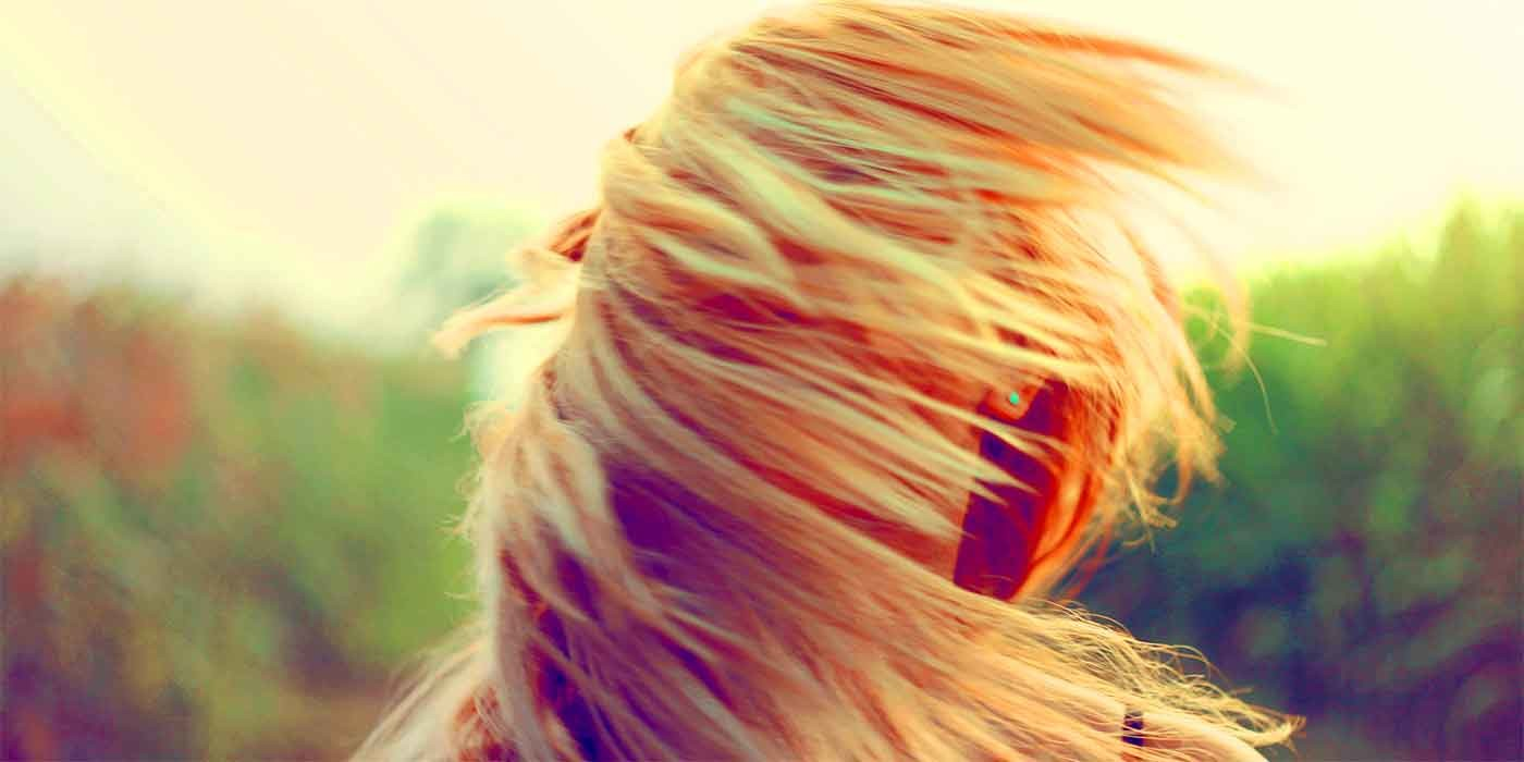 Photo of someone's hair blowing in the wind