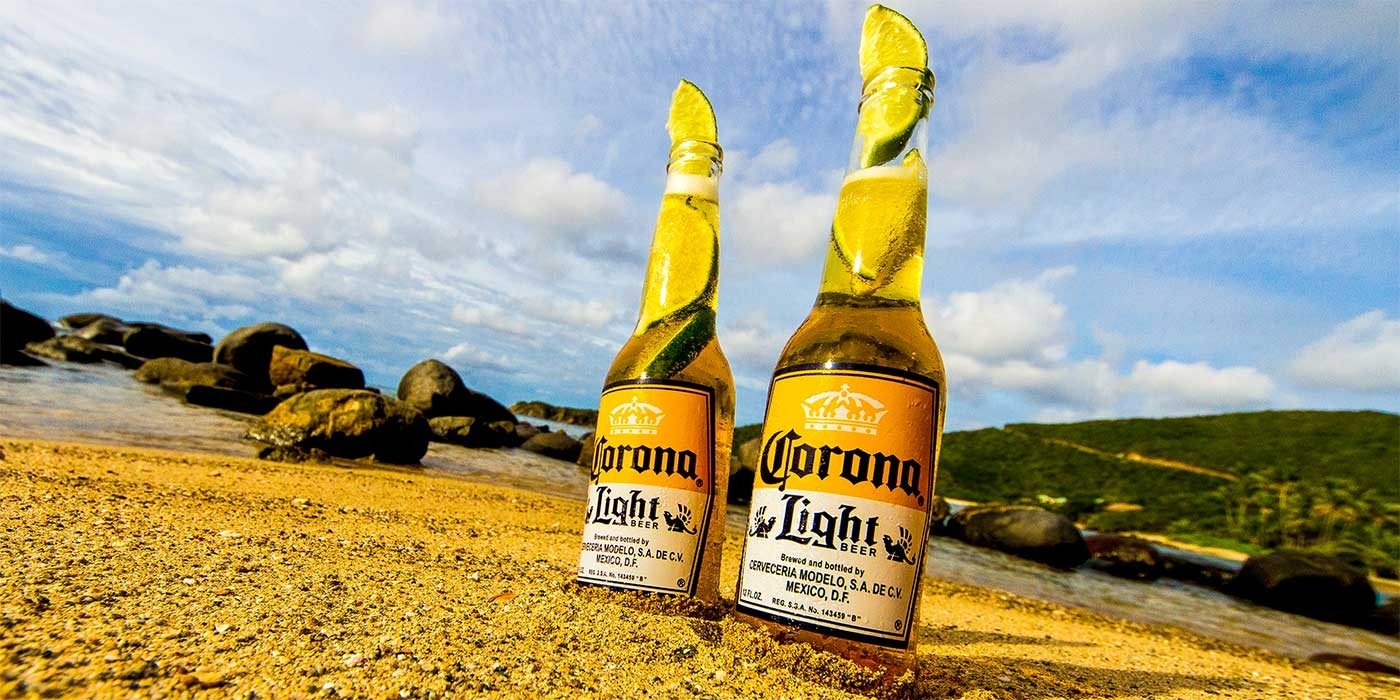 Photo of Corona bottles on a beach