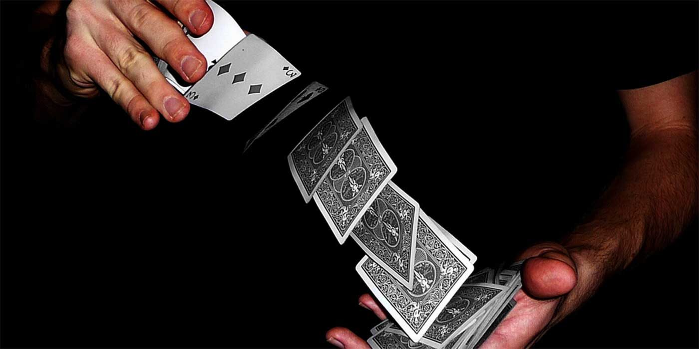 Photo of a magician with a deck of cards