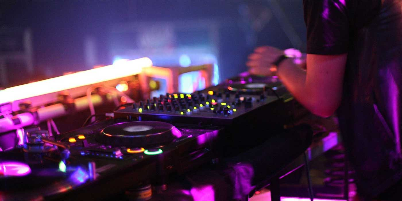 Photo of a DJ on stage