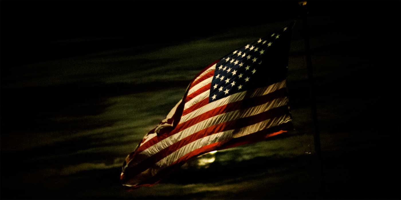 Photo of an American flag in the dark