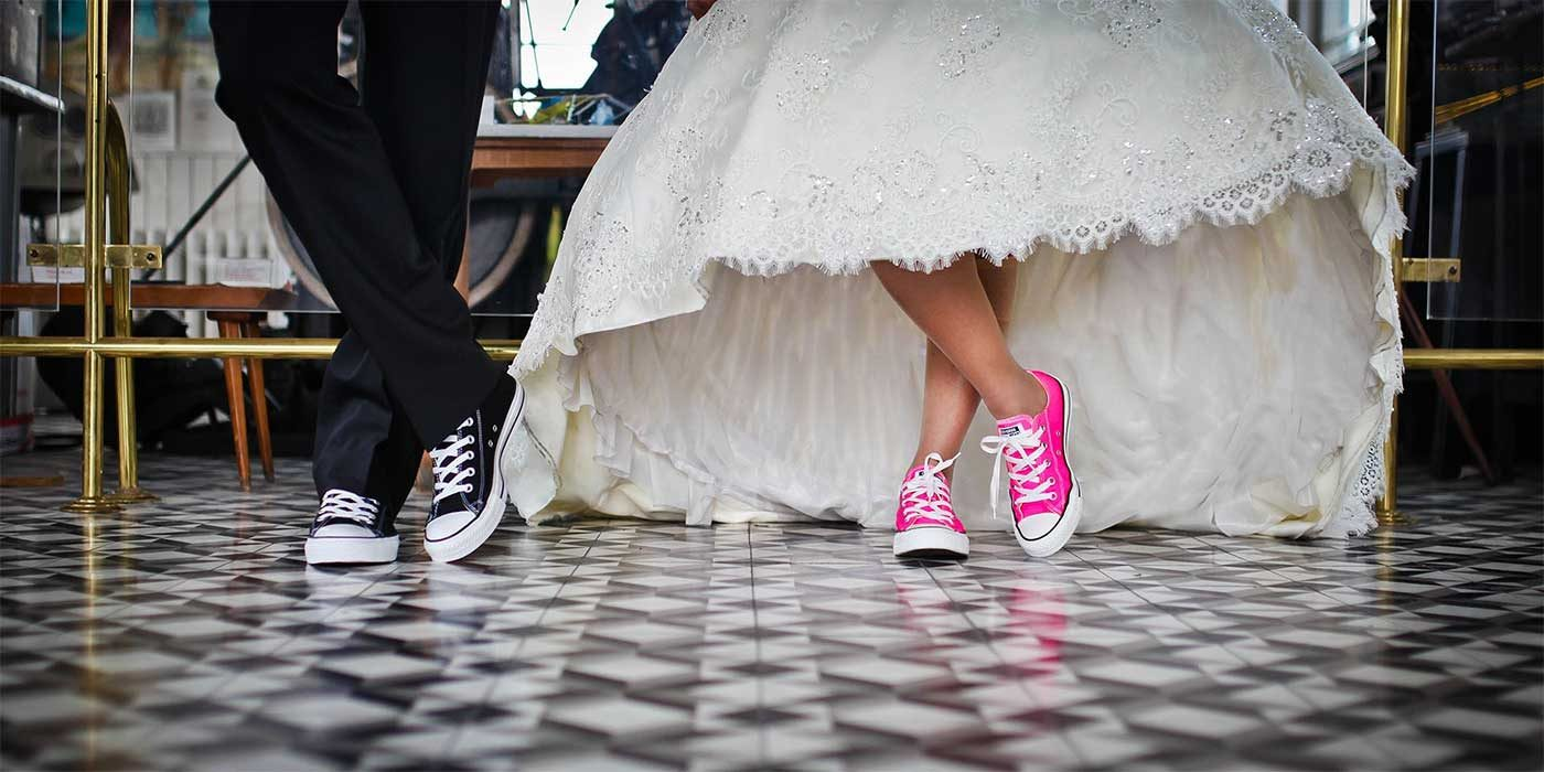 Photo of a Bride and Groom wearing converse