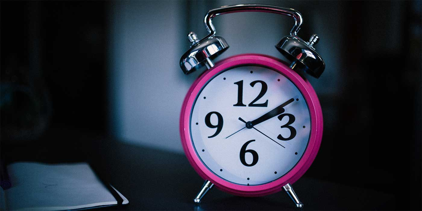 Photo of a pink alarm clock