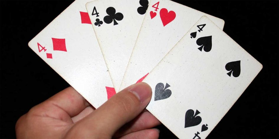 Photo of a hand of four cards
