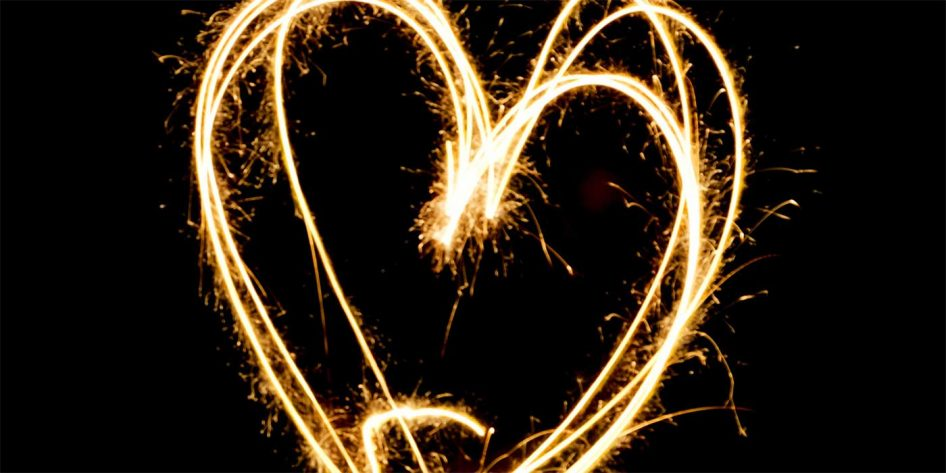 Photo of a sparkler drawing a heart in the air