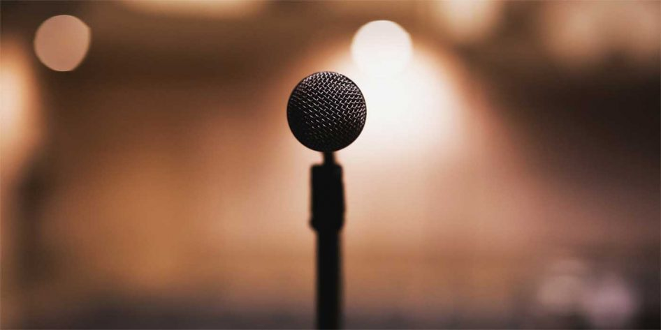 Photo of a microphone on stage