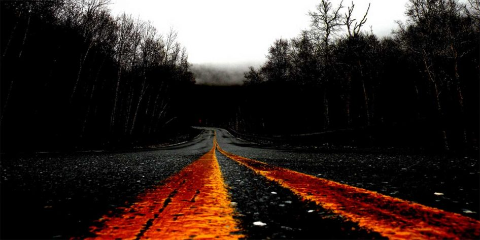 Photo of a spooky road at night