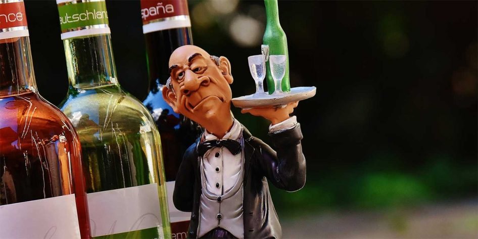 Photo of a toy waiter with wine bottles