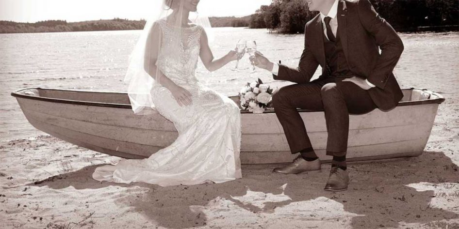 Photo of a bride and groom on a boat