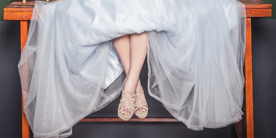 Photo of a bride sitting on a table