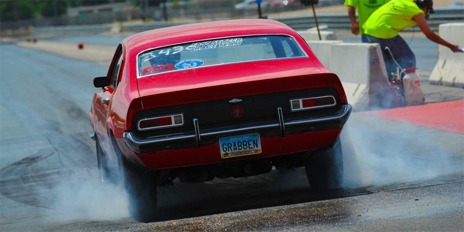 Photo of the tyre smoke from a muscle car