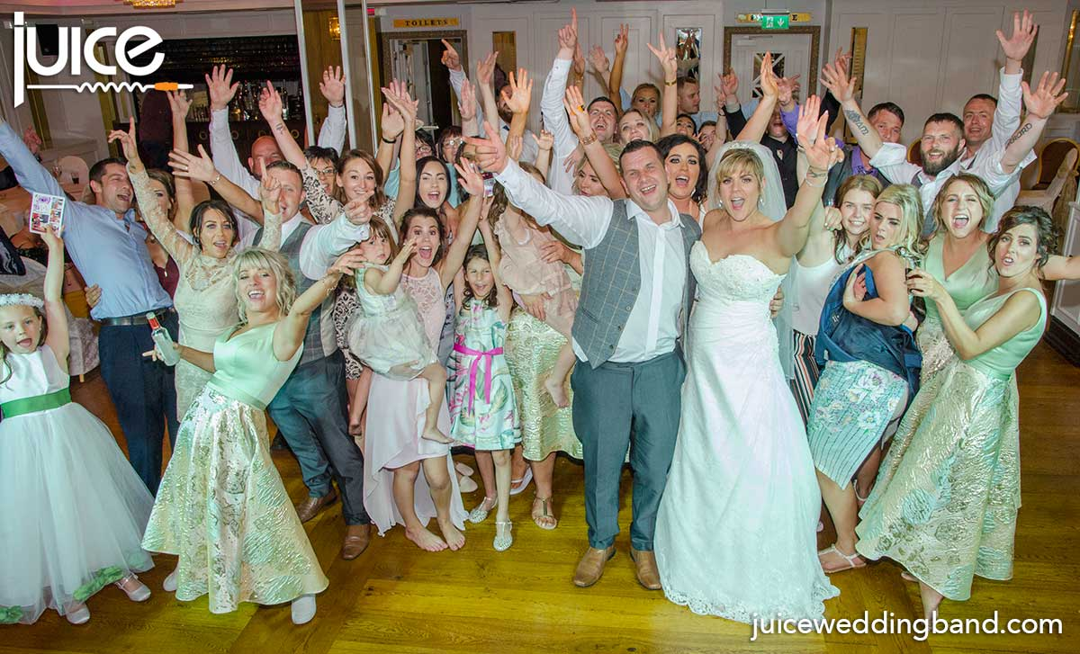 Photo of Niamh, John and their wedding guests in the Whistledown Hotel Warrenpoint