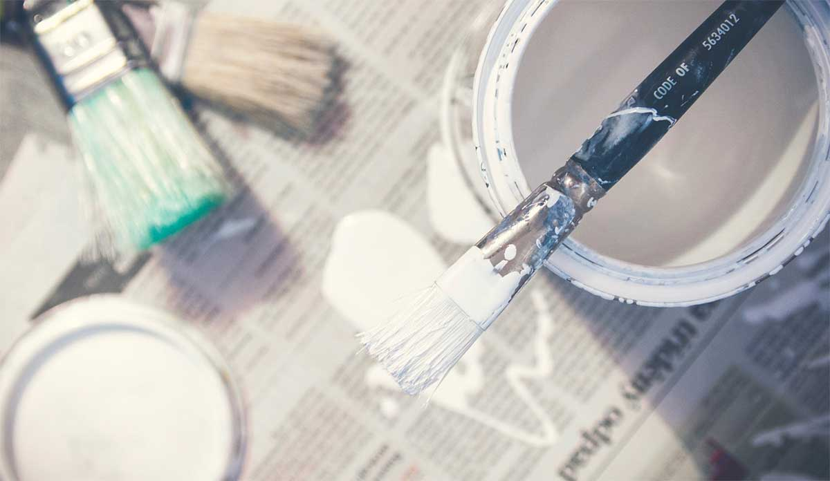 Photo of paint and paint brushes for renovation a house after a wedding