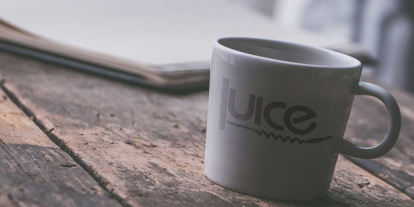 White cup with the Juice wedding band logo on it