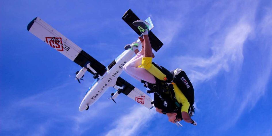 Photo of a sky diver free falling from a plane