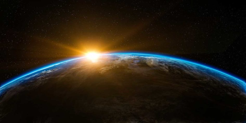Photo the world from space with the sun rising above it