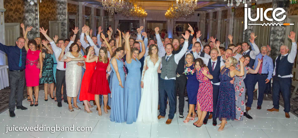 Photo of Laura, Gary and their wedding guests
