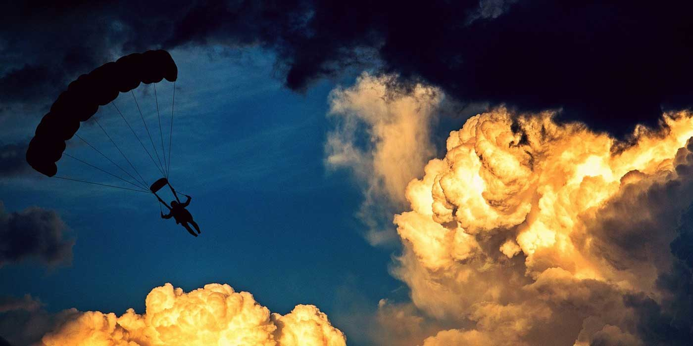 Photo of a parachutist in the sky