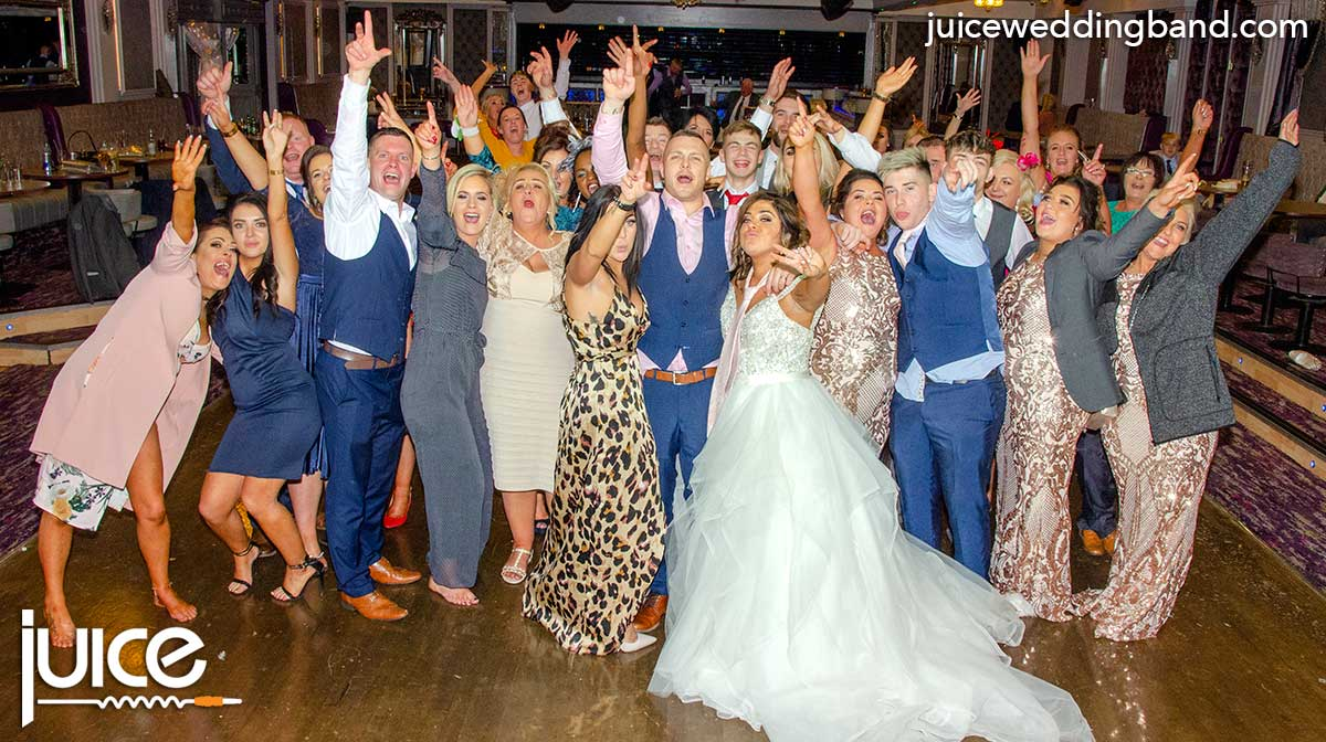 Photo of Danielle, Lee and their wedding guests
