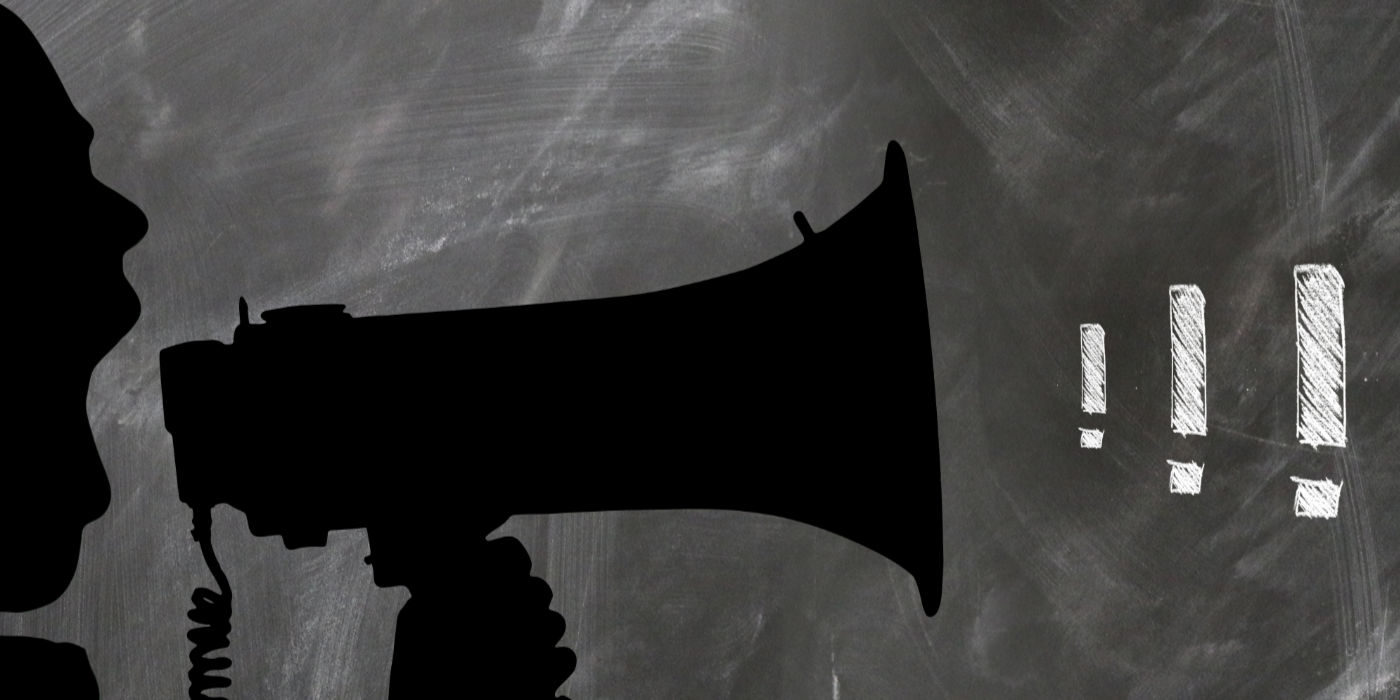 Picture of a man shouting into a megaphone