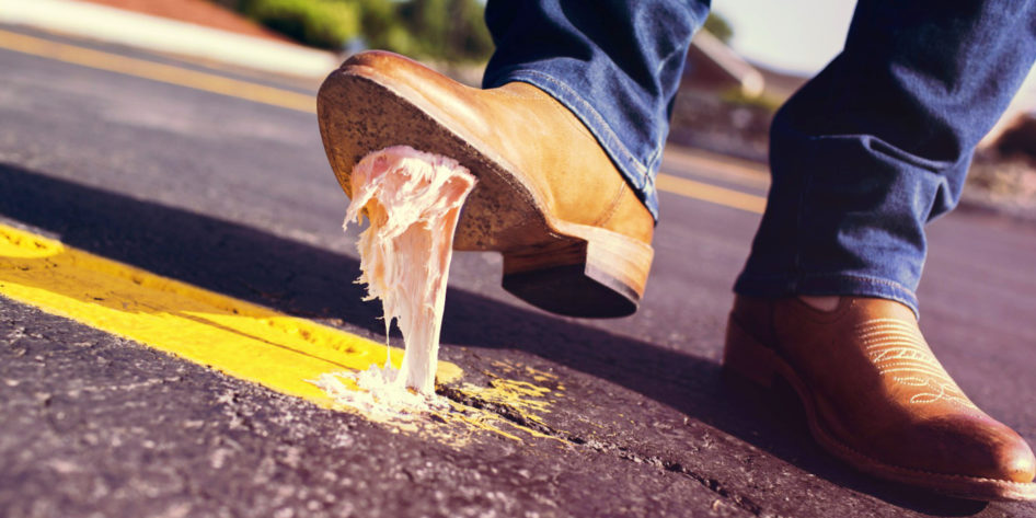 Photo of a boot stuck to the road with chewing gum