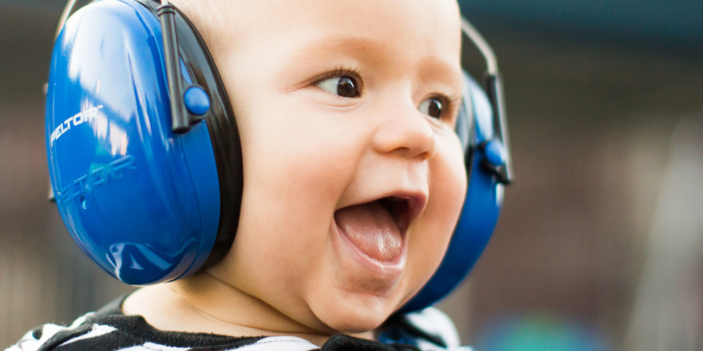 Photo of a baby wearing a large pair of headphones