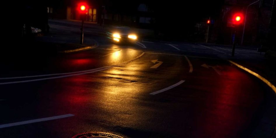 Photo of a road at night