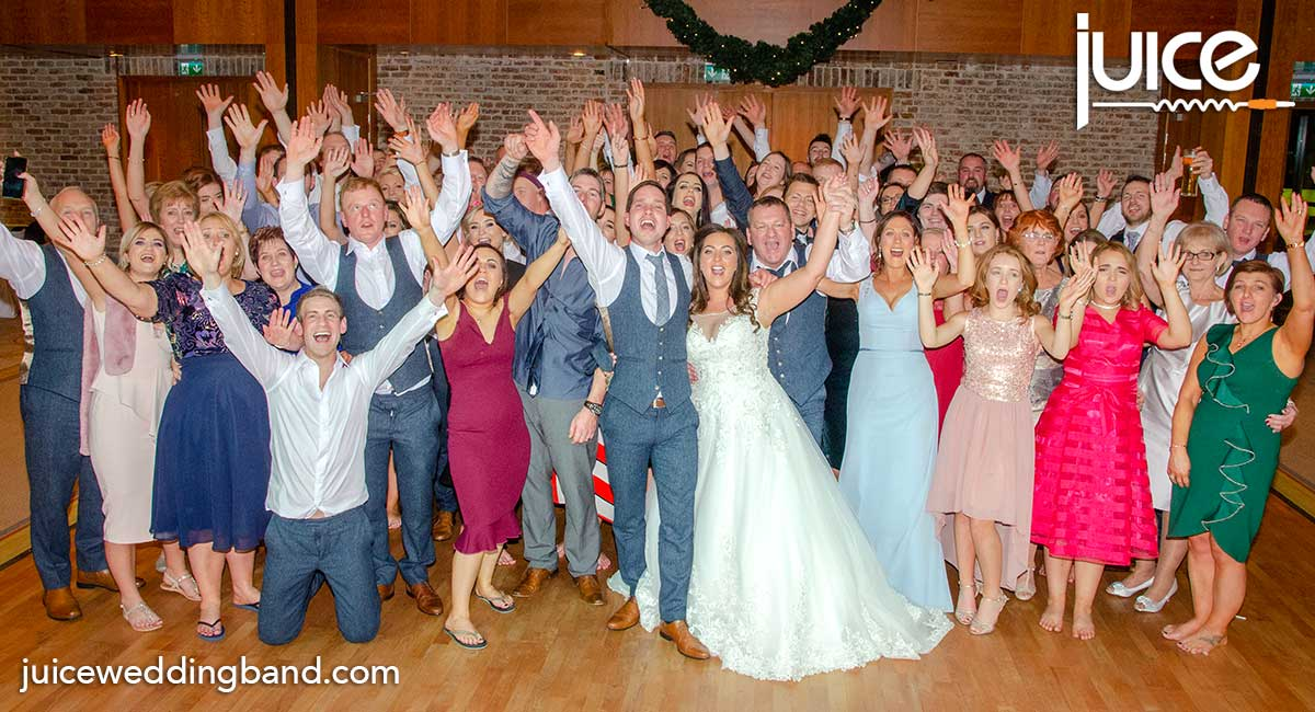 Photo of Stephanie, James and their wedding guests