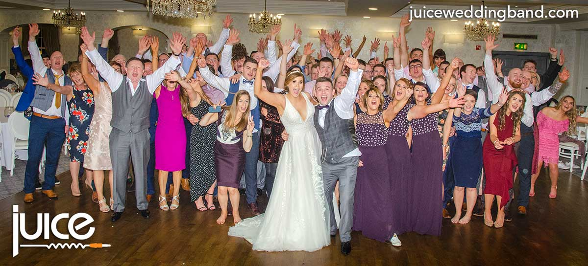 Photo of Jen, Peter and their wedding guests