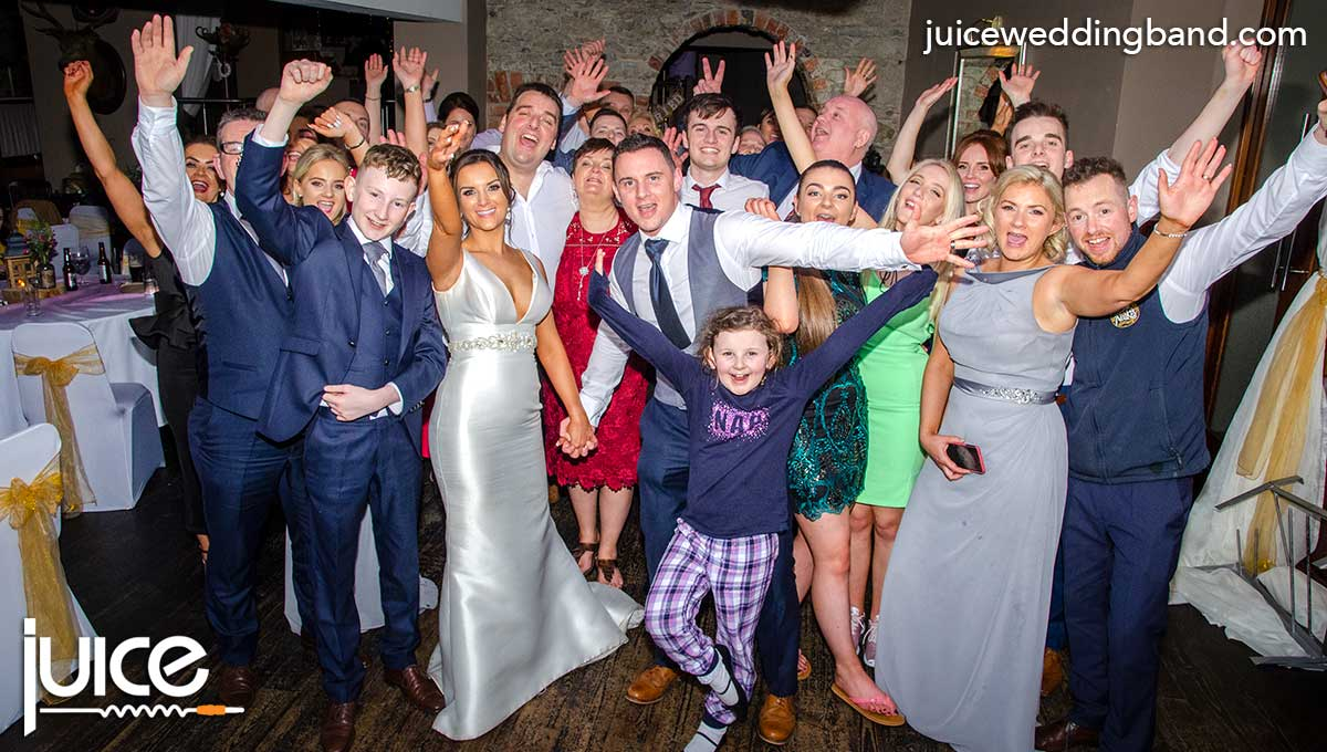 Photo of Laura, Lee and their wedding guests