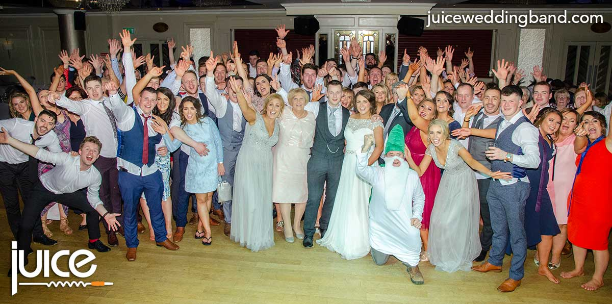Photo of Berniece, John and their wedding guests