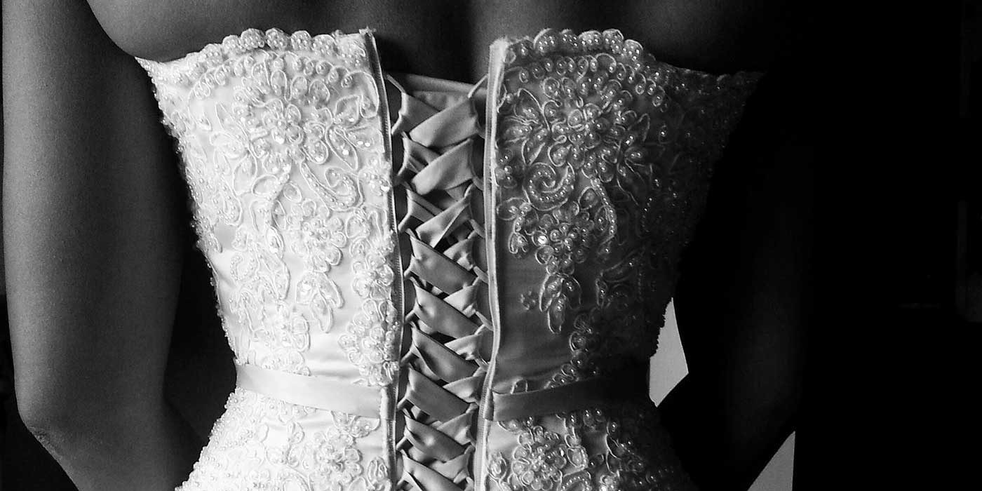 Photo of the back of a bride's lace up dress