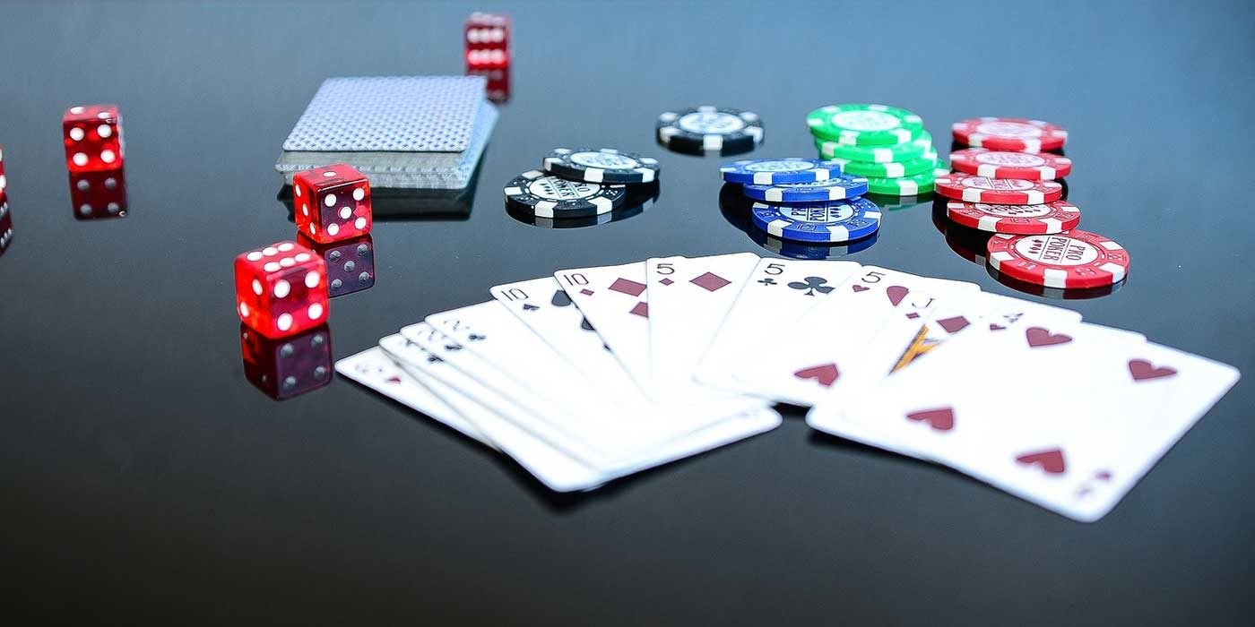 Photo of cards, poker chips and dice