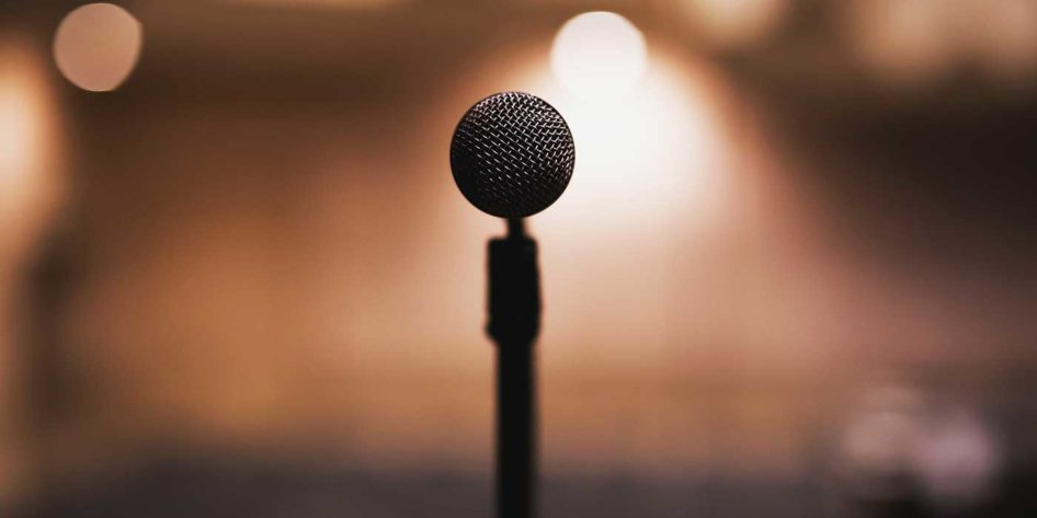 Photo of a microphone on a stage