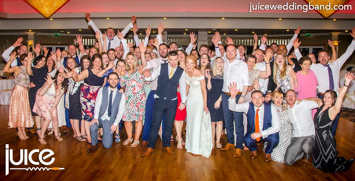 Photo of Clare, Liam and their wedding guests