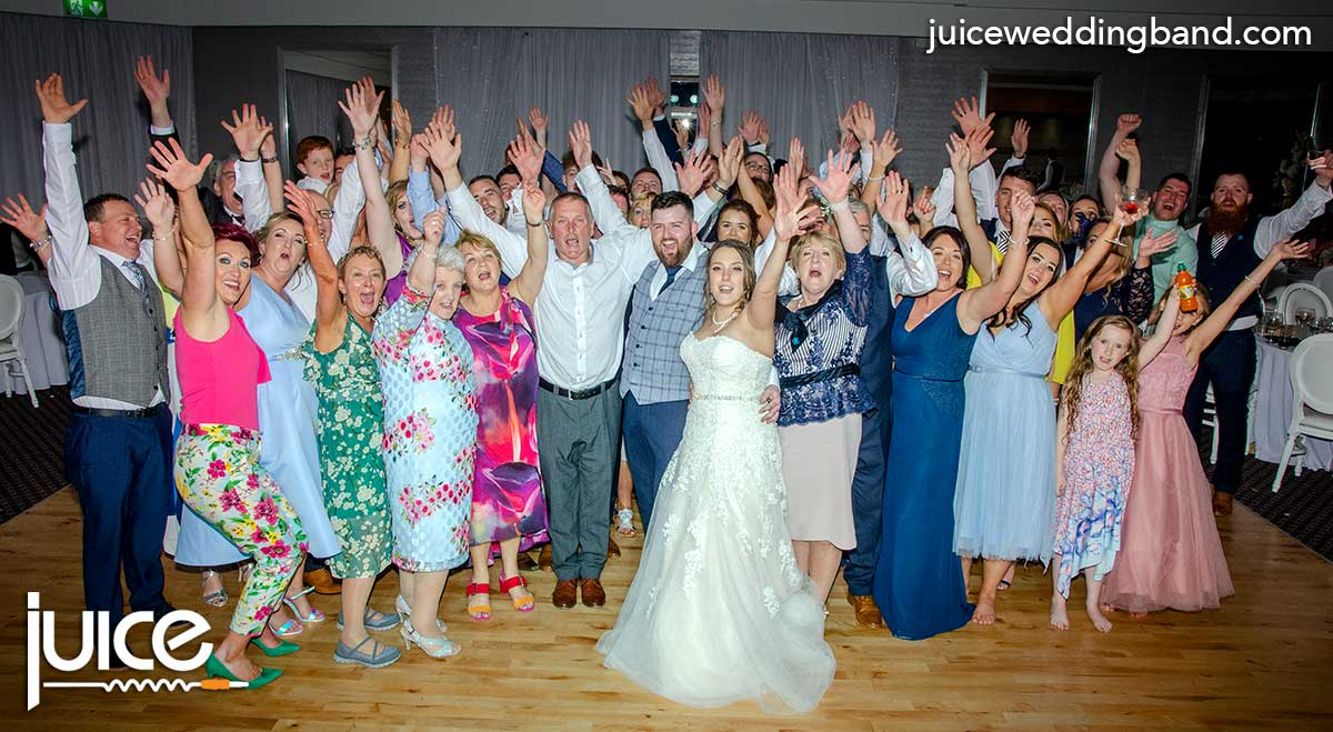 Photo of Emma, Jonny and their wedding guests