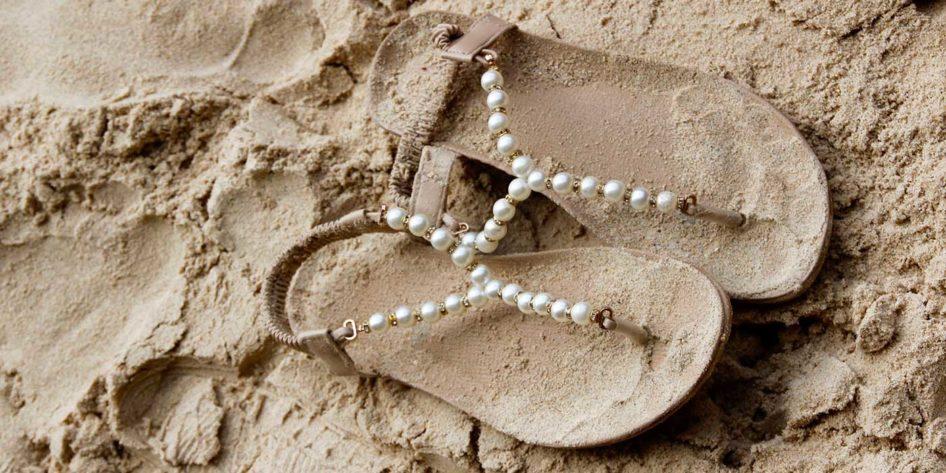 Photo of flip flops on a beach