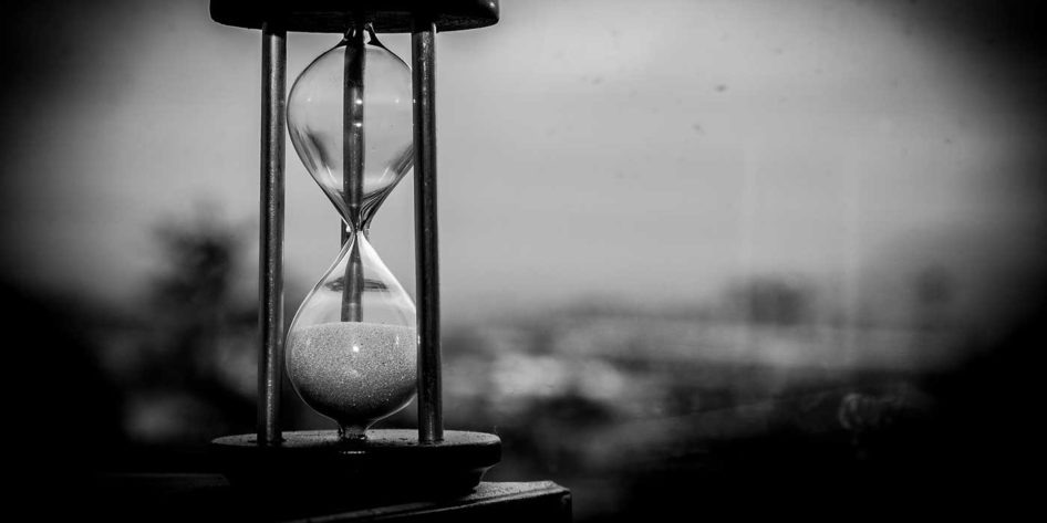 Photo of an hourglass showing time elapsing