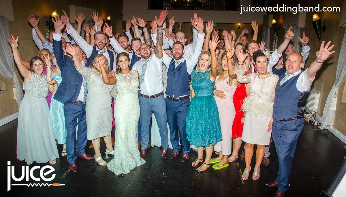 Photo of Rachel, Graham and their wedding guests
