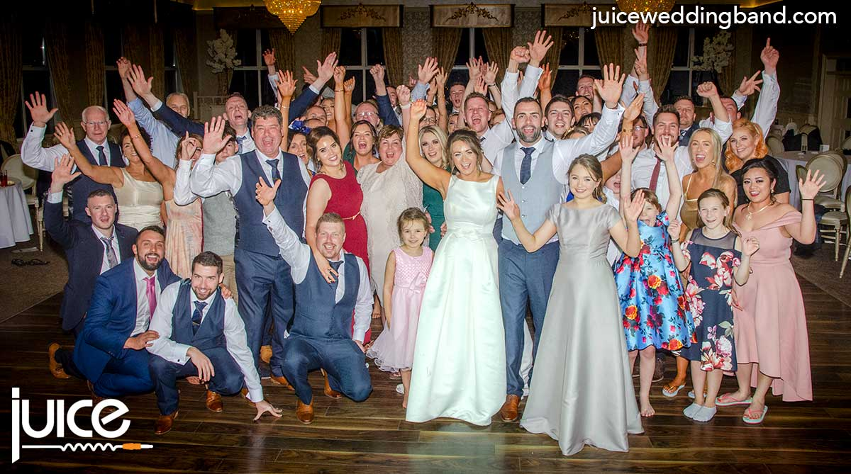 Photo of Rachel, Adam and their wedding guests