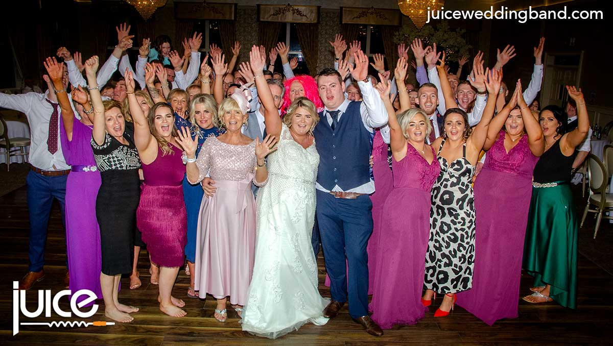 Photo of Rebecca, Kieran and all their wedding guests