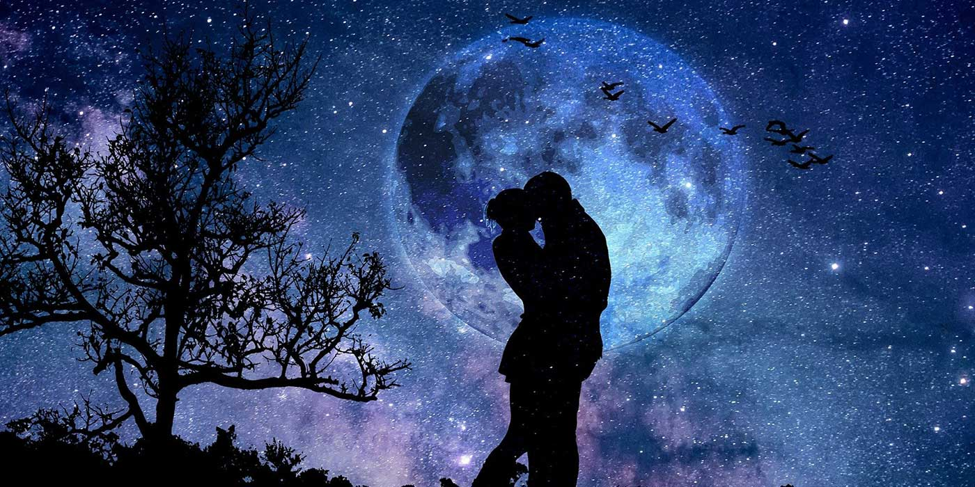 Photo of a couple under the moon